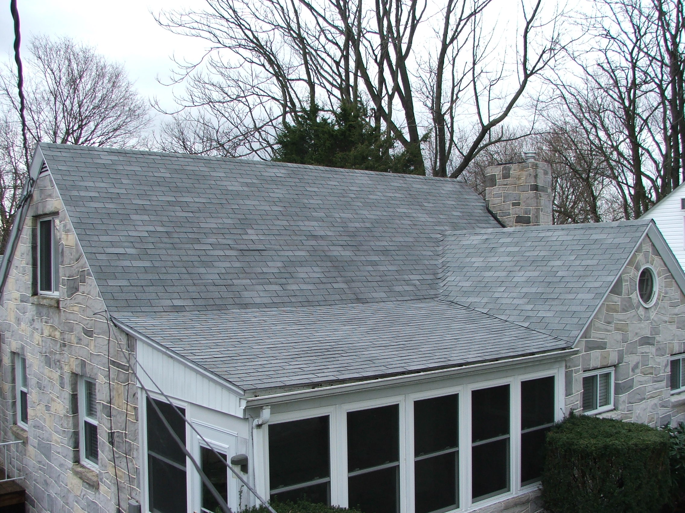 After low pressure washing and cleaning of a house roof in Harrisburg PA