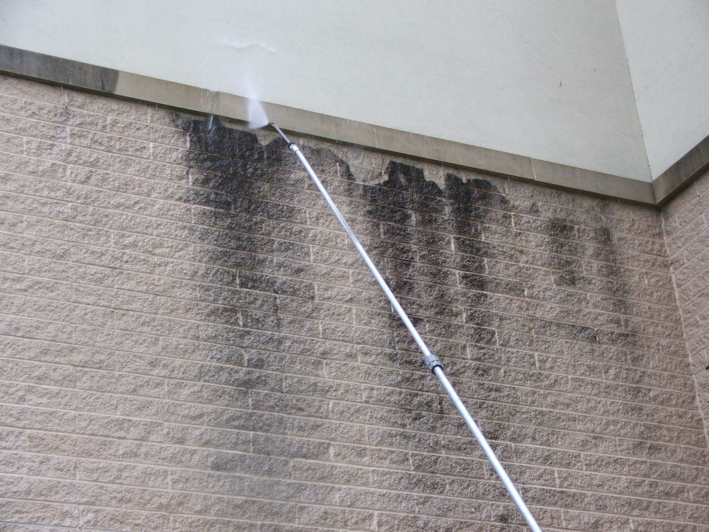 Masonry block wall pressure washing to remove black stains at a nursing home in Harrisburg.