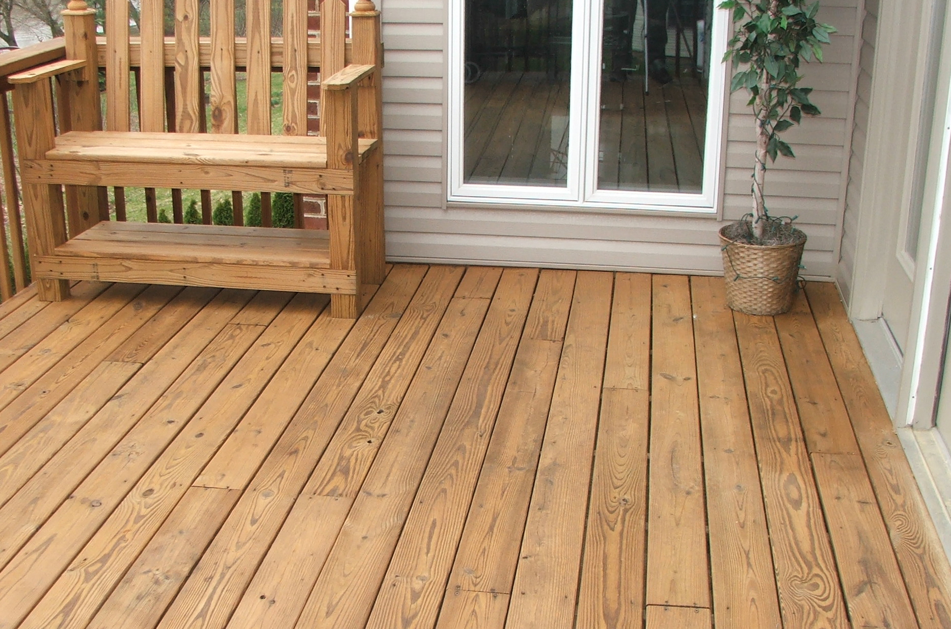 Wood deck after pressure washing and seal/staining protection using a cedar toner product. Typical three(3) year preformance.
